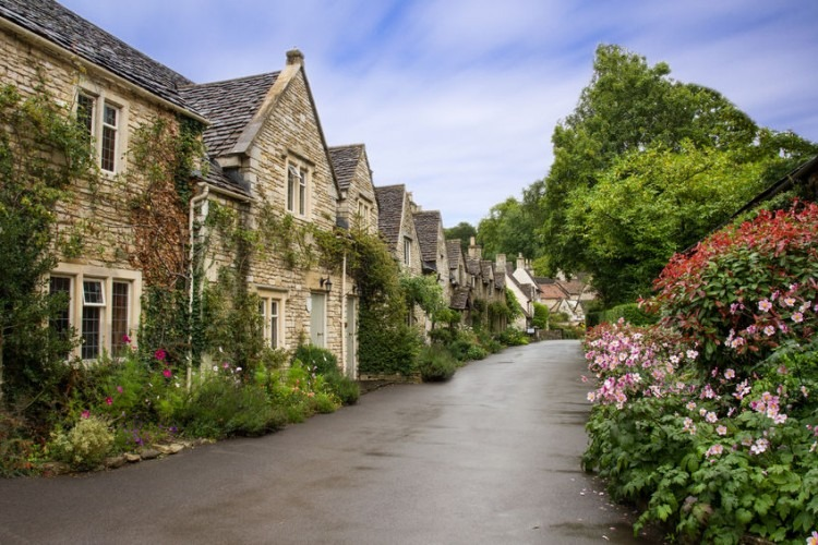 Beautiful summer view of the street in Combe Castle, Wiltshire, UK   Photo by Ian Sherriffs via 123RF