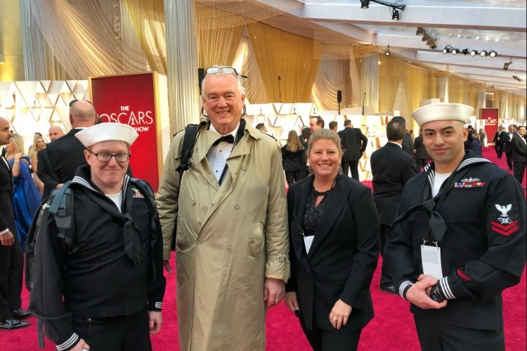 AFN's MC3 Dary Patten (far left), Fabian Montgomery (in tan coat), Keren Olsen and MC2 Devin Monroe (far right) were on the red carpet of the Oscars, capturing messages of support to the U.S. military from Hollywood stars.  (Photo by Eric Gabriel)
