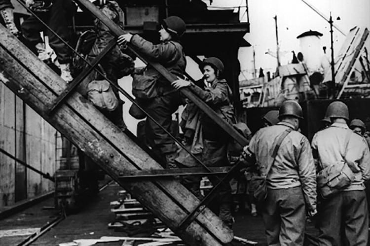 Army nurses board a ship prior to the Normandy invasion in 1944. U.S. Army