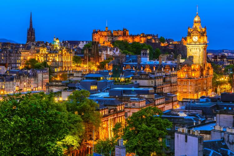Edinburgh at nightfall | Photo by Ionut David
