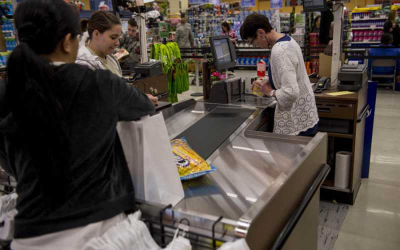 A customer checks out at the cash register inside the new Spangdahlem commissary during the grand opening of the facility on Thursday, May 19, 2016, at Spangdahlem Air Base, Germany. Commissaries are among the facilities struggling with the hiring freeze. RUSTY FRANK/U.S. AIR FORCE