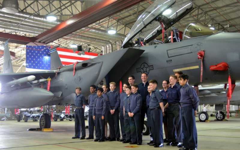Royal Air Force Air Cadets pose with their instructor for a photograph with an F-15 Eagle fighter jet during a tour of U.S. Air Force operations and equipment at RAF Lakenheath, England, Friday, April 7, 2017. WILLIAM HOWARD/STARS AND STRIPES
