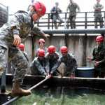 JROTC cadets carefully maneuver an obstacle at the leadership reaction course, Thursday, June 22, 2017, at Grafenwoehr, Germany.  MARTIN EGNASH/STARS AND STRIPES