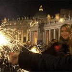 People hold firecrackers in St. Peter's square at the Vatican at midnight on a past New Year's Eve. (AP Photo/Pier Paolo Cito)